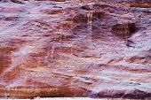 Multicolored Sandstone Wall Of Gorge Siq In Petra