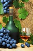 Bottle, Glass Of Cognac And Bunch Of Grapes