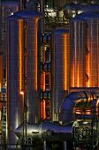 Copper Colored Pipes Of A Chemical Production Facility At Night