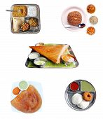 Indian Breakfast Items-dosa, Idly, Chapatti And Pilaf With Chutney And Curries Isolated
