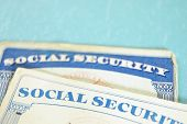 stock photo of social-security  - closeup of US Social Security cards on blue - JPG