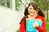 image of bagpack  - young student with her book school having thum up - JPG