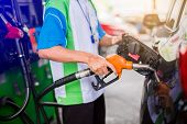 Hands Refilling The Black Car With E20 Fuel At The Gas  Station, Black Car In Gas Station, Refilling poster