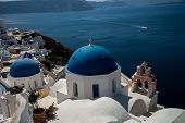 The Most Famous View Of The Dome Of The Orthodox Church In Firostefani, Santorini, Greece. One Of Th poster