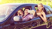 Happy Young Friends Taking Selfie While Traveling Together By Car - Guys And Girls Having Fun Taking poster