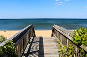 Walkway Leading To Ocean View Beach In Norfolk, Virginia With The Chesapeake Bay In The Background. poster