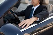 foto of car ride  - A young man in a luxury sports car - JPG