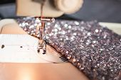 Close-up Photo Of Sewing Machine With Shiny Piece Of Fabric. Prom Dress Preparation. Fashion Design  poster