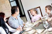 Happy family having dinner in the dinning room