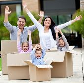 Family with arms up celebrating they are moving home