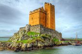 stock photo of fortified wall  - Kilcoe castle on the coast of Co - JPG