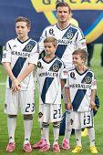 CARSON, CA - DECEMBER 1: David, Brooklyn, Romeo, and Cruz Beckham before the 2012 MLS Cup at the Hom