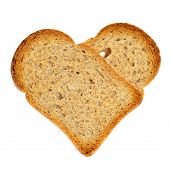 a couple of bread rusks forming a heart on a white background