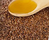 flax seed linseed and spoon oil closeup