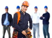 stock photo of  multimeter  - Portrait of a smiling worker in front of his team - JPG