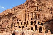Tourists visiting the Royal Tombs  in Petra, Jordan.