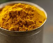 picture of curcuma  - curcuma spice in metal bowl macro shot soft focus - JPG