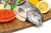 Trout, Red Caviar In A Glass Bowl And Lemon Close Up