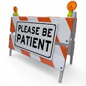Please Be Patient words on a construction barrier or blockade to thank you for waiting for a delay o