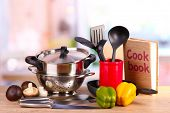 stock photo of food preparation tools equipment  - composition of kitchen tools and vegetables on table in kitchen - JPG