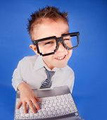 stock photo of eye-wink  - Five years old boy with a laptop computer - JPG