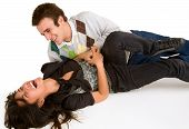 foto of tickle  - A youn girl is being tickled by a young man - JPG