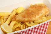 Fish & chips takeaway meal in cardboard box.