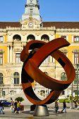 BILBAO, SPAIN - NOVEMBER 14: Town Hall and sculpture Variante Ovoide de la Desocupacion de la Esfera