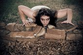 stock photo of night crawler  - A woman zombie crawls out with a menacing look - JPG