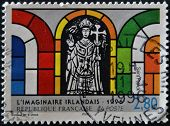 postage stamp shows a detail of a stained glass window of St. Patrick Irish imaginary sample