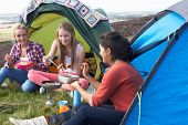 Group Of Teenage Girls On Camping Trip In Countryside