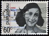 A stamp printed in The Netherlands shows image of Anne Frank