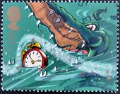 A stamp printed in Great Britain shows Crocodile and Alarm Clock. Stamp dedicated to Peter Pan