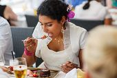 Beautiful Happy Indian Bride Eating On Wedding Dinner.