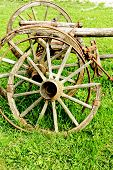 pic of chariot  - old broken wooden wheel spokes side by chariot - JPG