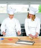 Senior Chef Teaching Newbie Female Chef