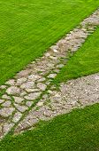 Stone Path Through A Green Lawn