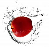 First Plane Of Red Apple Falling In Water