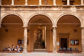 BOLOGNA, ITALY - SEP 10 : Students relax in the portico outside Bologna University