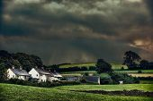 Rural hamlet with stormy skies