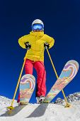 Ski, skier, sun and winter fun - woman enjoying ski vacation