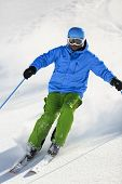 Ski, Skier, Freeride in fresh powder snow - man skiing downhill