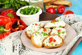 picture of hardtack  - Sandwiches with cottage cheese and greens on plate on wooden table close - JPG