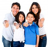 Happy family portrait with thumbs up - isolated over white background
