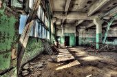 Old abandoned factory, indoors.