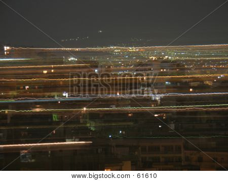 poster of Streaking Lights Over The City