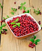 Lingonberry Ripe In Bowl On Board