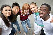 stock photo of ethnic group  - young people of different ethnic groups on the schoolyard   - JPG