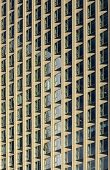 foto of parallelogram  - The photograph of a facade with the uniform pattern of parallelograms - JPG