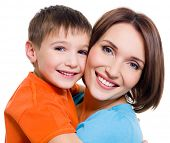 Young happy cheerful mother with little son on a white background